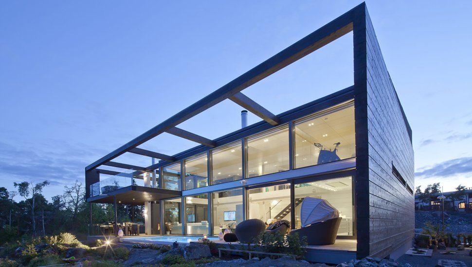 Blockhaus mit großen Fensterflächen