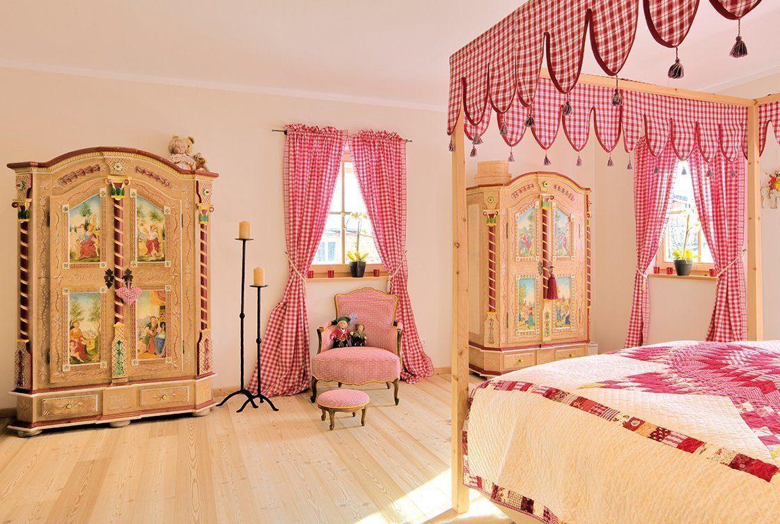 Vitalhaus Kirchberg - Ein Schlafzimmer mit einem Stofftier - Bett