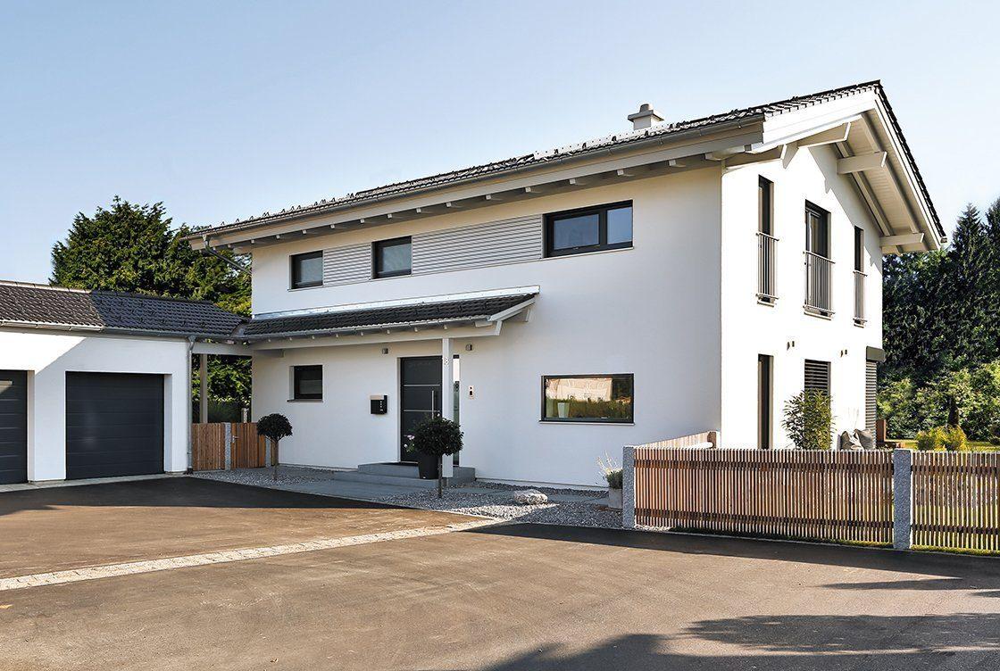 Vitalhaus Bruckmühl - Eine Bank vor einem Haus - Haus