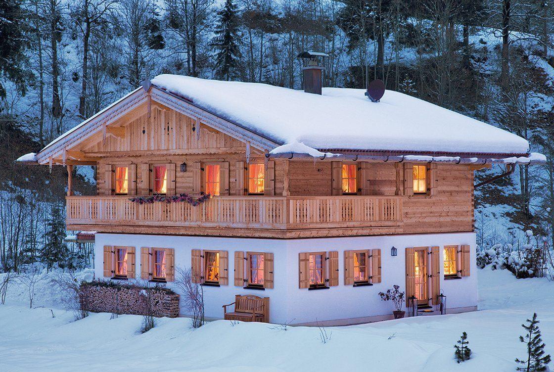 Vitalhaus Kirchberg - Ein Haus mit Schnee bedeckt - Holzhaus