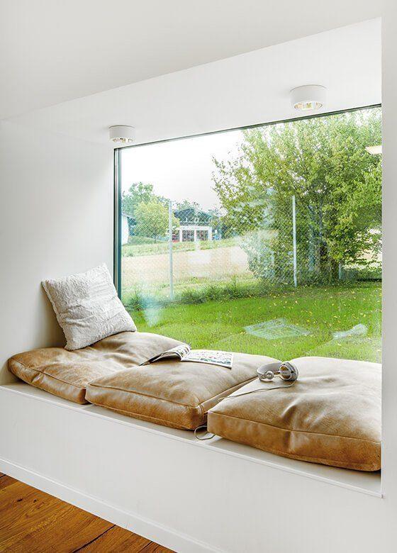 Musterhaus Ambienti+ - Ein großes Bett in einem Raum - Die Architektur