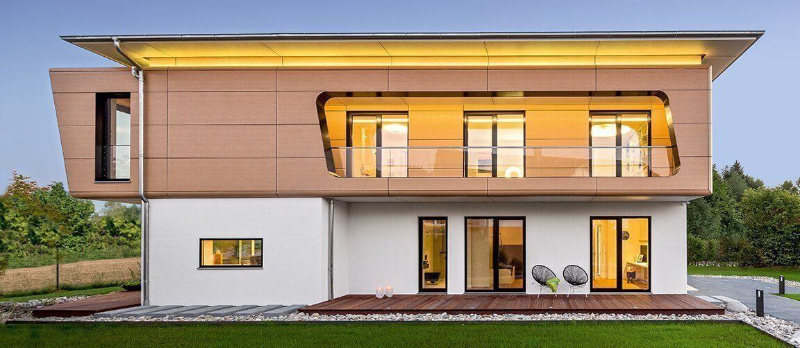 Musterhaus Ambienti+ - Eine Nahaufnahme von einem gelben Gebäude - Haus