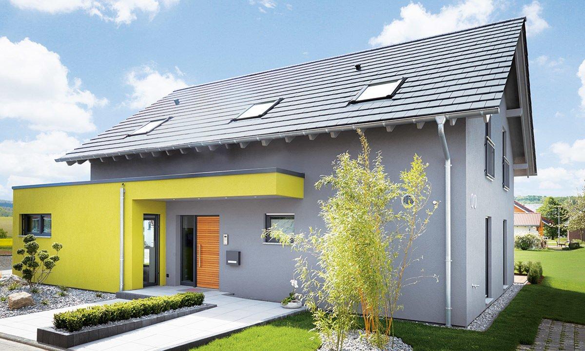 Musterhaus Koblenz - Ein gelbes haus im hintergrund - Fingerhut Haus GmbH & Co. KG