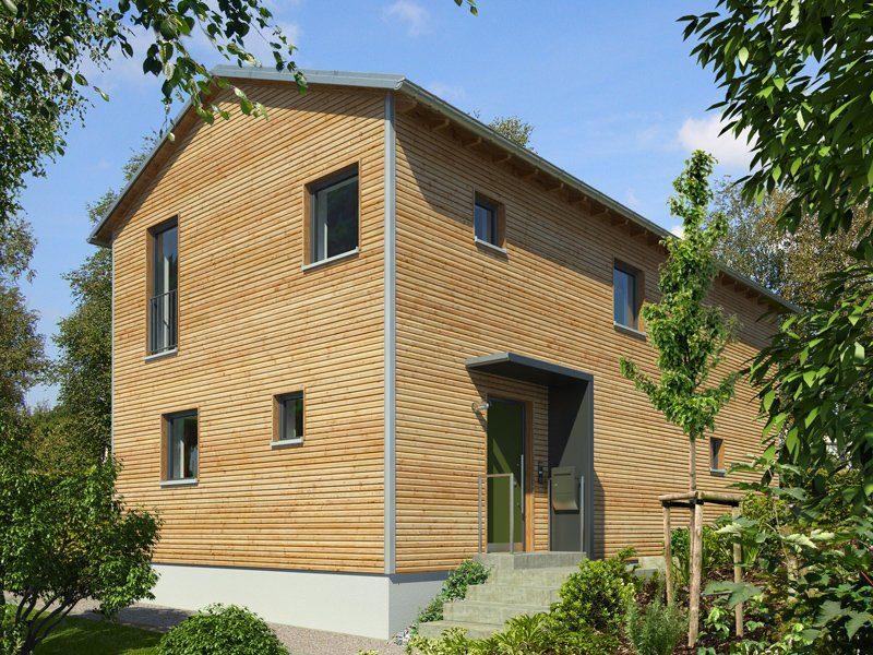 Hochhinaus - Ein Haus mit Büschen vor einem Backsteingebäude - Haus