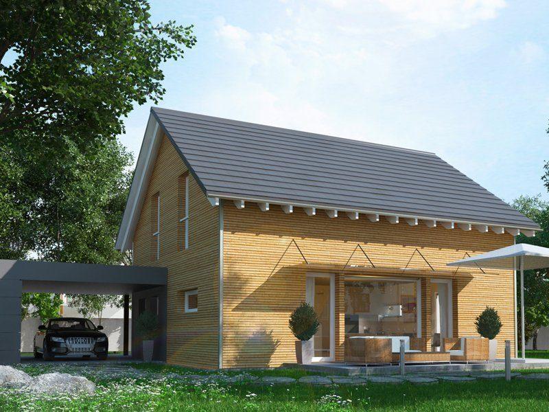 Klassisch & Fein - Ein großes Backsteingebäude mit Gras vor einem Haus - Fertighaus