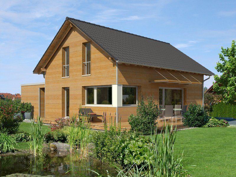 Klassisch und fein - Ein Haus mit Büschen vor einem Backsteingebäude - Holzhaus