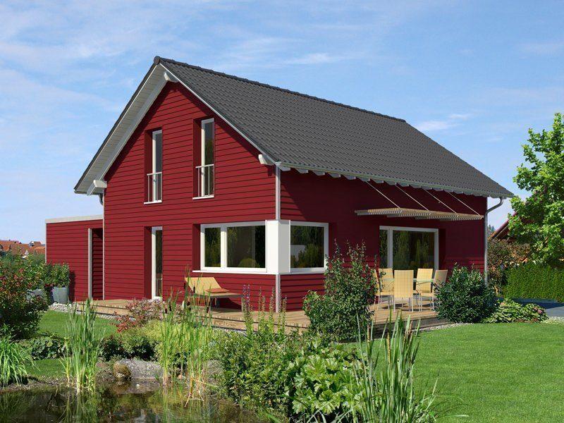 Klassisch & Fein - Ein rotes Backsteingebäude mit Gras vor einem Haus - Bau-Fritz GmbH & Co. KG, seit 1896