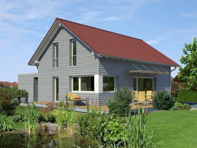 Klassisch & Fein - Ein haus mit büschen vor einem gebäude - Holzhaus