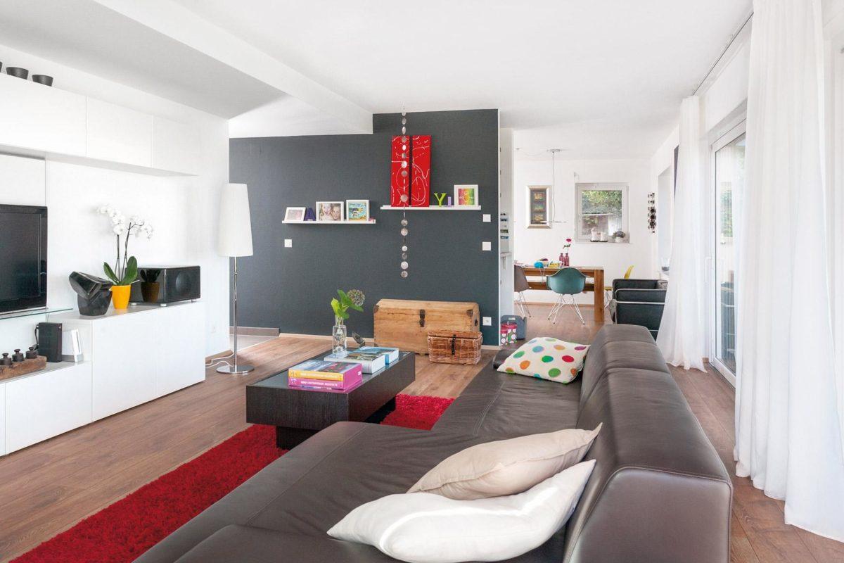 Plan E 20-167.1 - Ein Wohnzimmer mit Möbeln und einem Flachbildfernseher - Wohnzimmer