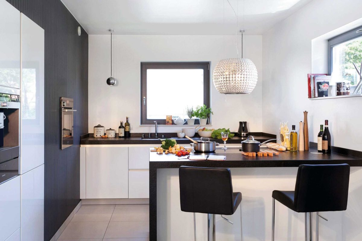 Plan E 15-146.1 - Eine Küche mit einer Insel mitten in einem Raum - SchworerHaus KG