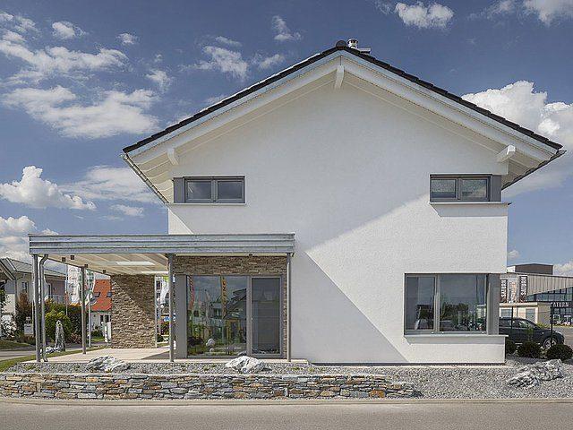 Musterhaus Lanos Wien - Ein großes weißes Gebäude - Haus