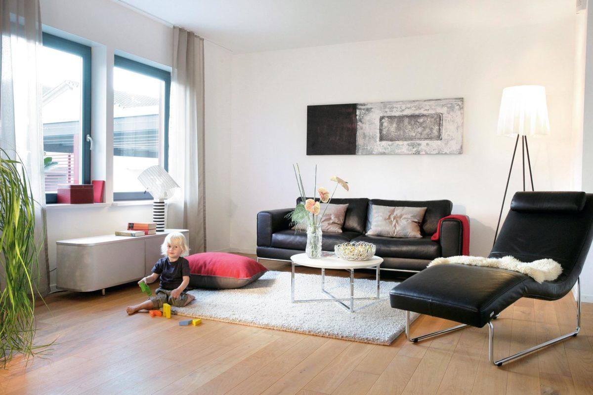 Plan E 20-137.1 - Ein Wohnzimmer mit Möbeln und einem großen Fenster - Einfamilienhaus