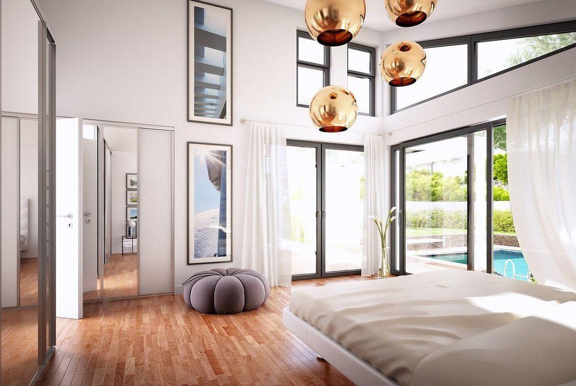 Bungalow Liberty - Ein Schlafzimmer mit einem großen Fenster - Haus