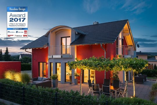 Kundenhaus Linz - Ein schild vor einem haus - Fertighaus
