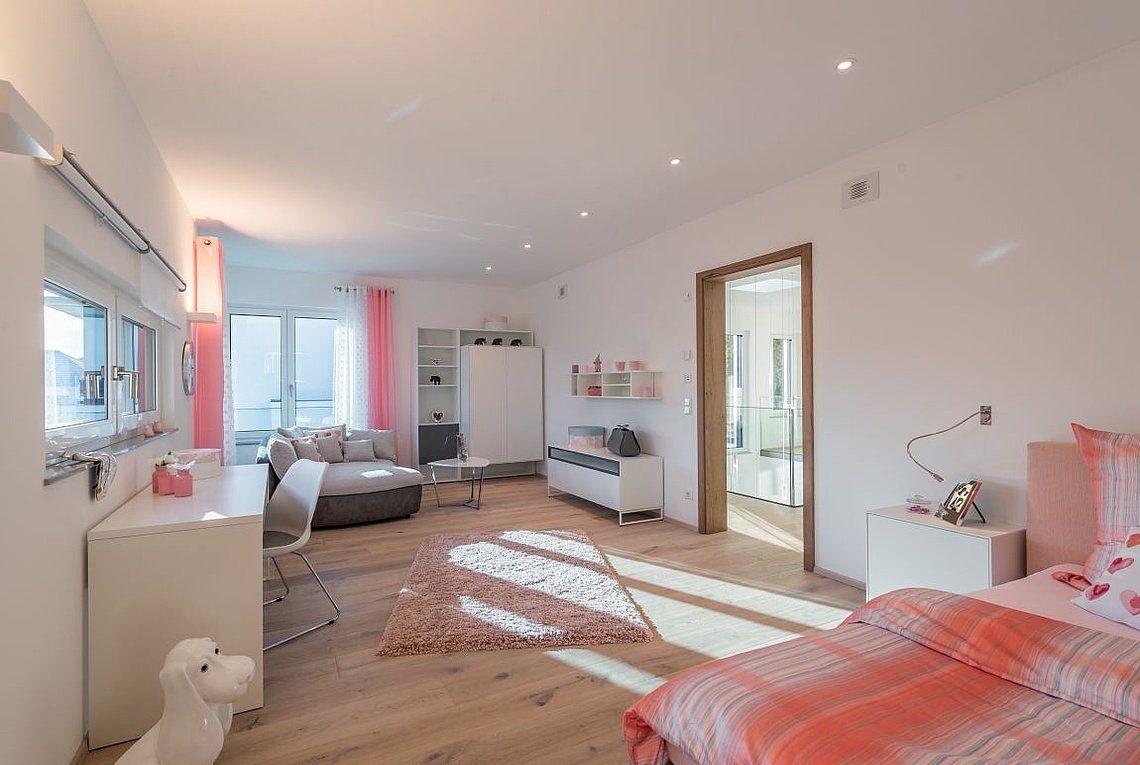 Musterhaus San Diego - Ein Schlafzimmer mit einem Bett in einem Raum - Haus zeigen