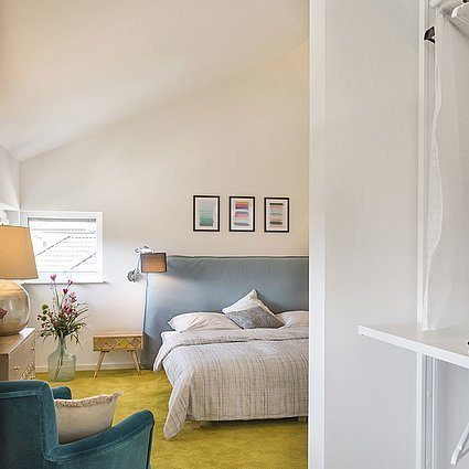 Musterhaus Lanos Wien - Eine Ansicht eines Wohnzimmers - Kamp