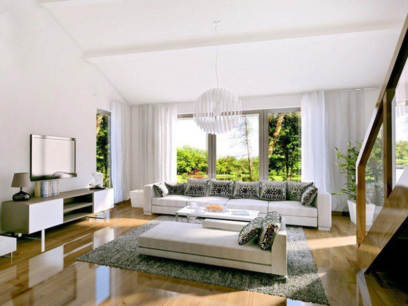 Brave 176 - Ein Wohnzimmer mit Möbeln und einem großen Fenster - Fertighaus