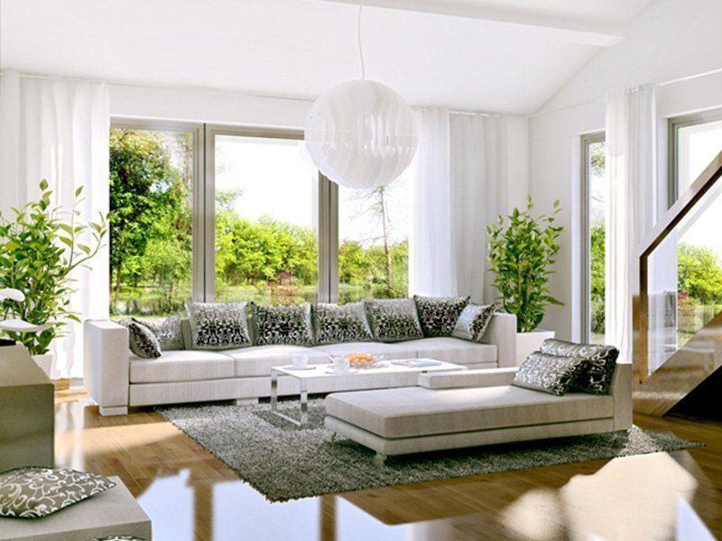 Brave 176 - Ein Wohnzimmer mit Möbeln und Blumenvase auf einem Tisch - Fertighaus
