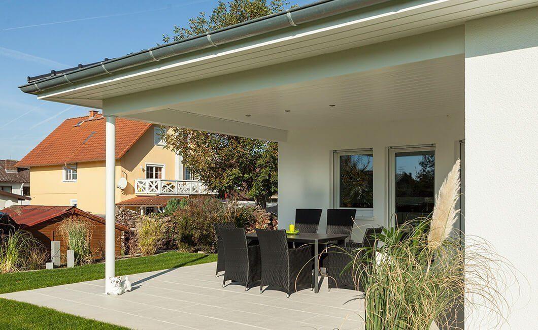 Edition 126 - Ein Haus mit Bäumen im Hintergrund - Haus