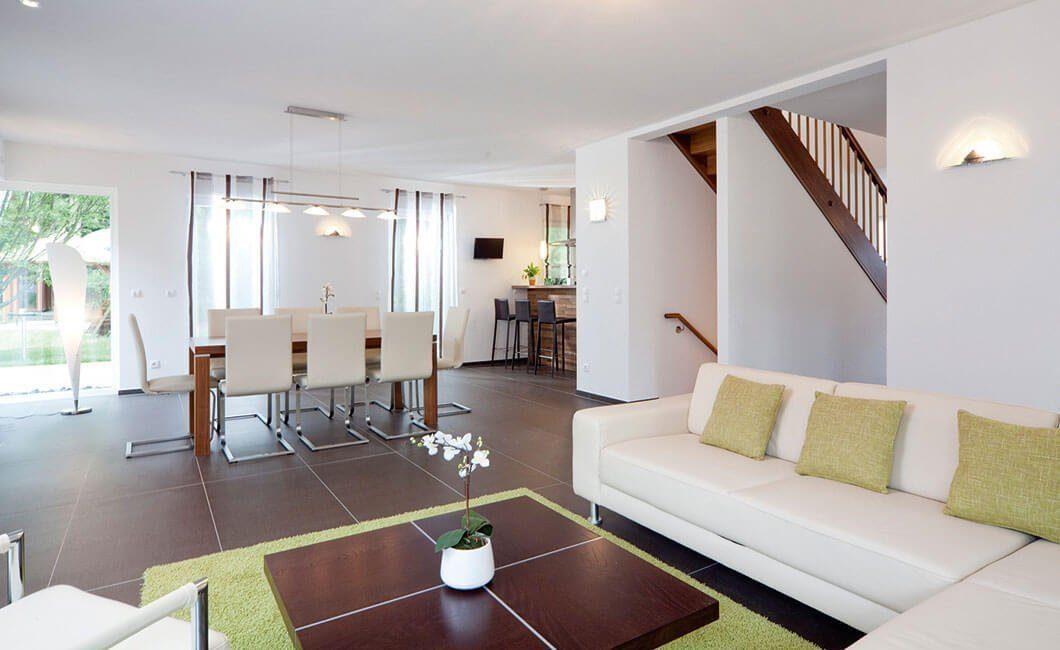 Edition Select 156 - Ein Wohnzimmer mit Möbeln und einem Flachbildfernseher - Knauf Feuerschutzplatte GKF