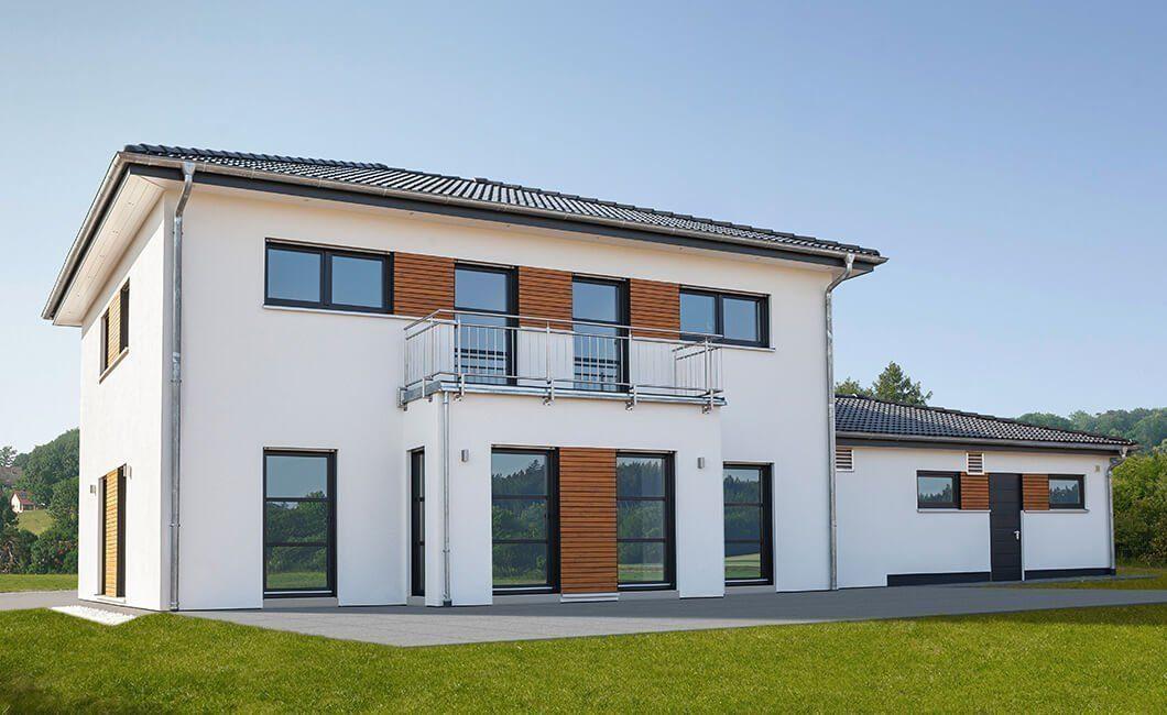 Edition 174 - Ein großes Backsteingebäude mit Gras vor einem Haus - Wolf-Haus GmbH