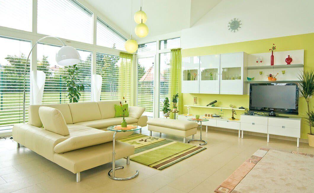 Edition Select 181 - Ein Wohnzimmer mit Möbeln und einem großen Fenster - Wohnzimmer