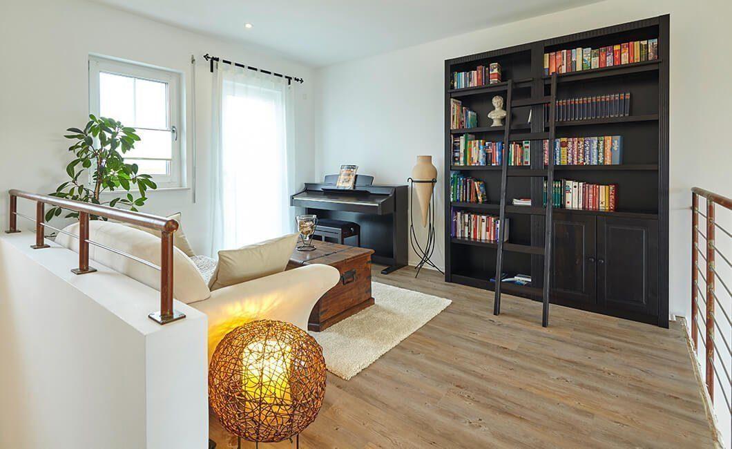 Edition Select 343 - Ein Wohnzimmer mit Möbeln und einem Flachbildfernseher - Interior Design Services