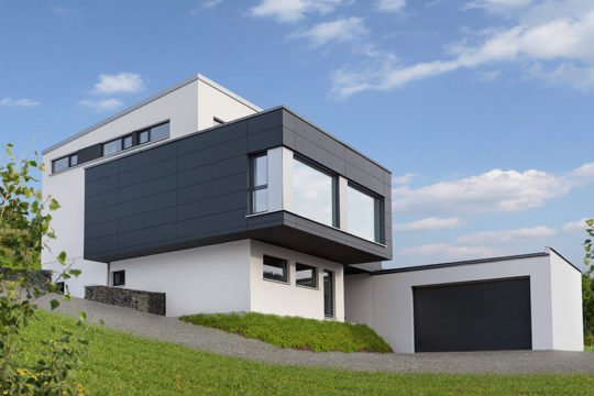 Edition Select 187 - Ein großes Backsteingebäude mit Gras vor einem Haus - Haus