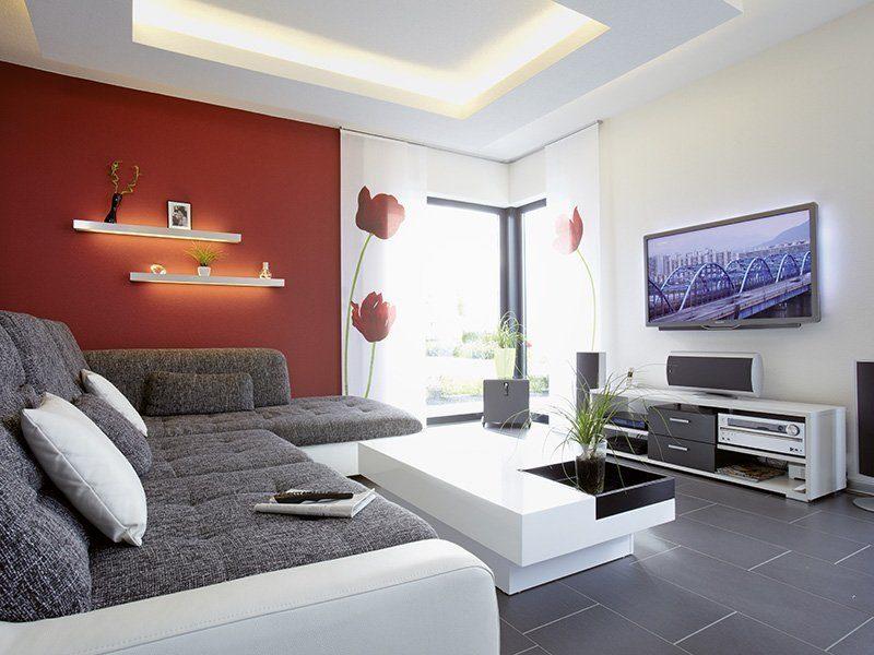 Ein Haus zum Wohlfühlen - Ein Raum mit Möbeln und einem Flachbildfernseher - Wohnzimmer