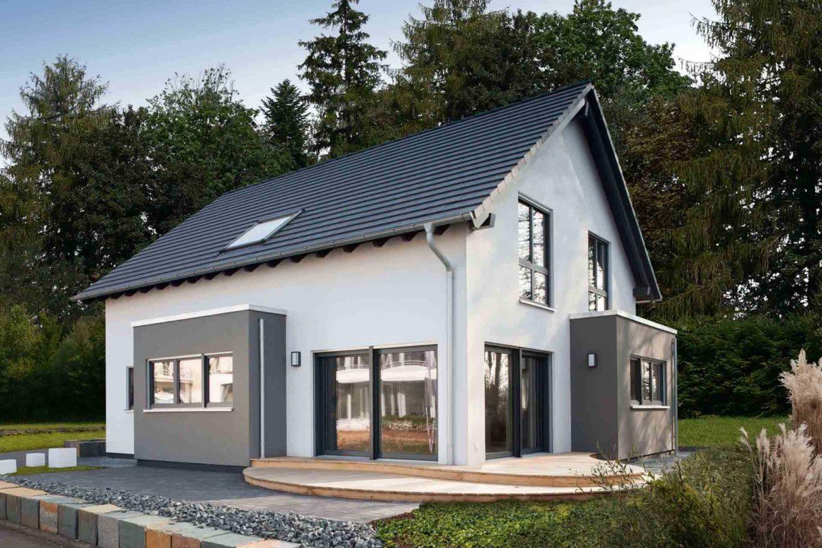 NEO 312 – Musterhaus Bad Vilbel - Ein Haus mit Bäumen im Hintergrund - FingerHaus