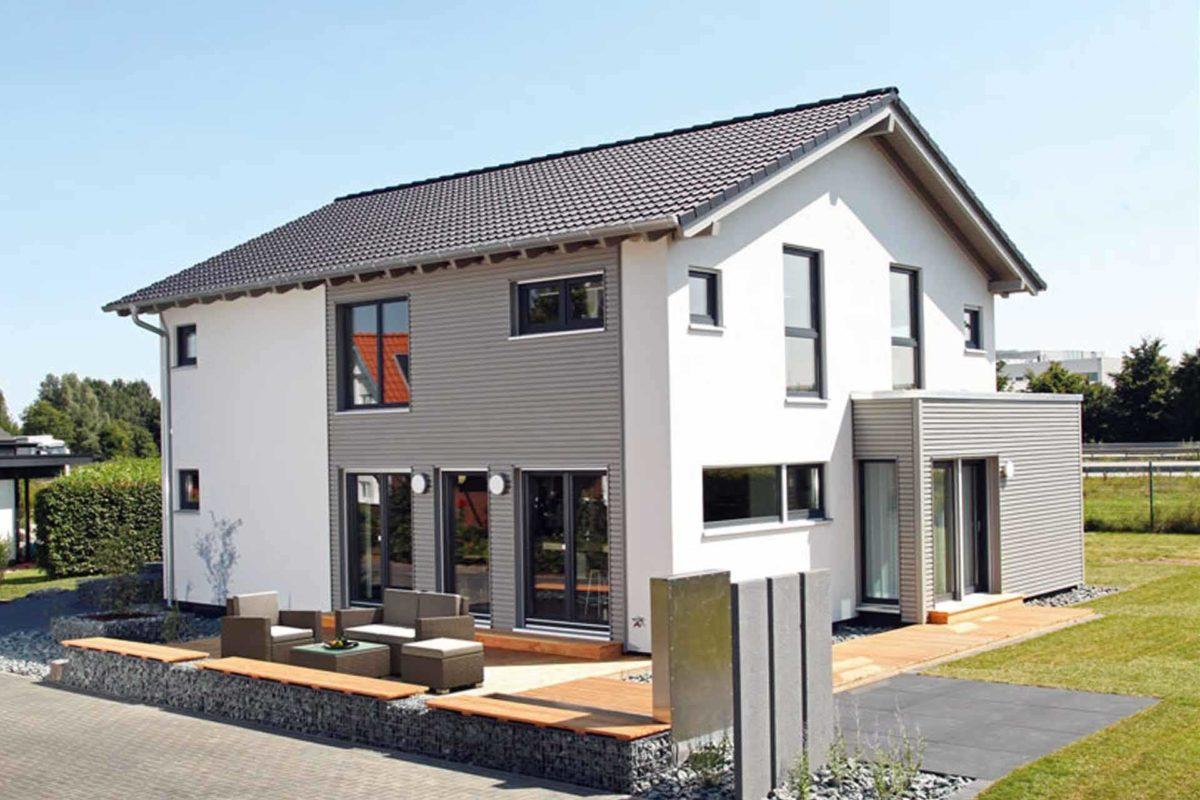Musterhaus Hannover – NEO 300 - Ein kleines haus im hintergrund - FingerHaus