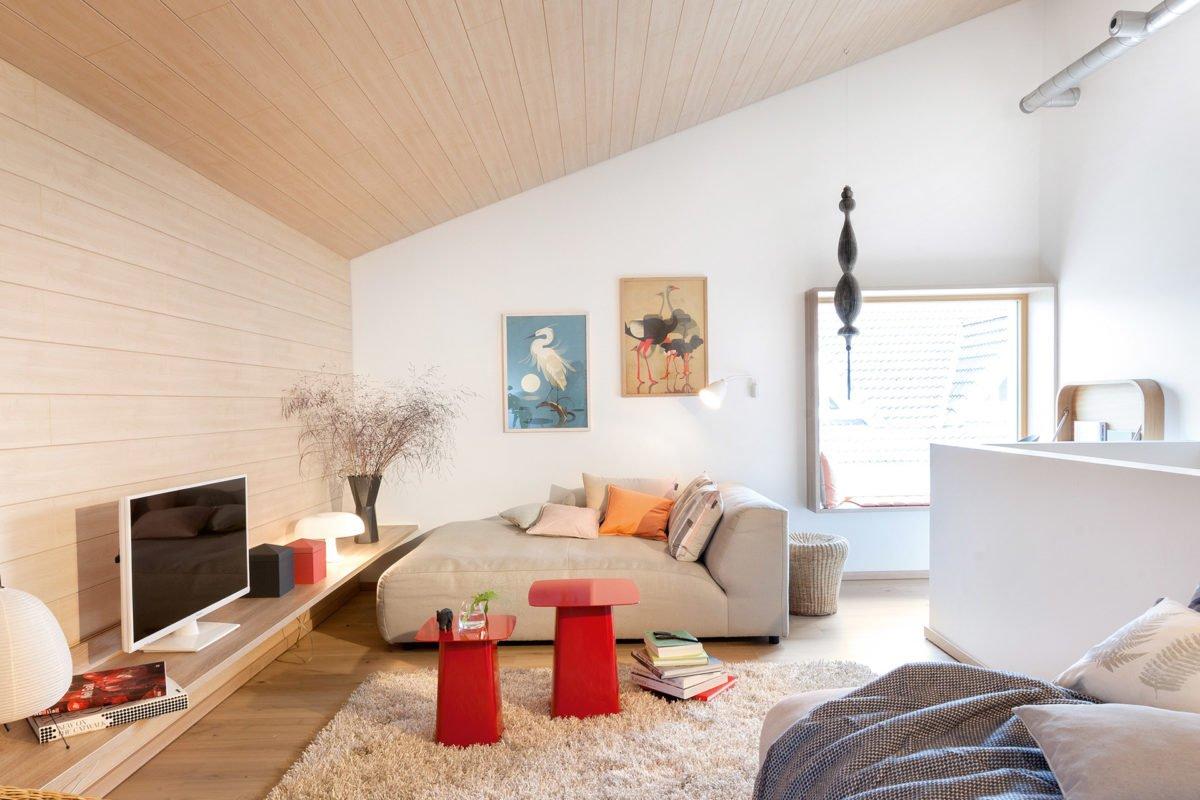 Musterhaus Mono - Ein Wohnzimmer mit Möbeln und einem Teppich - SchworerHaus KG