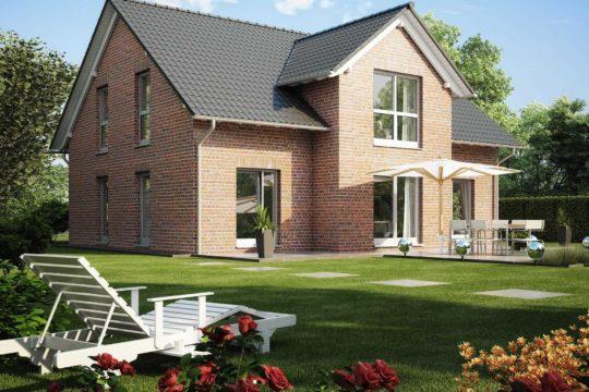 Haus Kiefernallee - Ein großes Backsteingebäude mit Gras vor einem Haus - Fassade