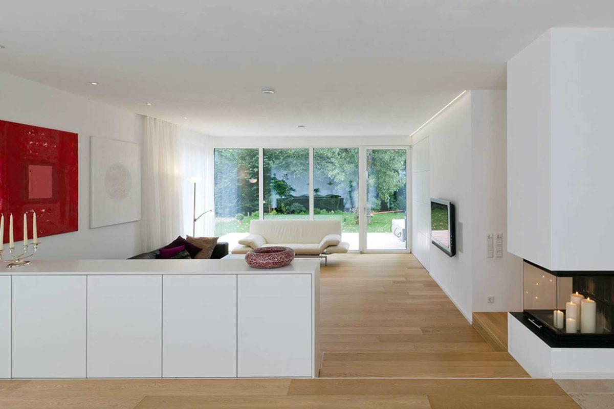 Killesberg - Ein Raum voller Möbel und ein großes Fenster - Interior Design Services