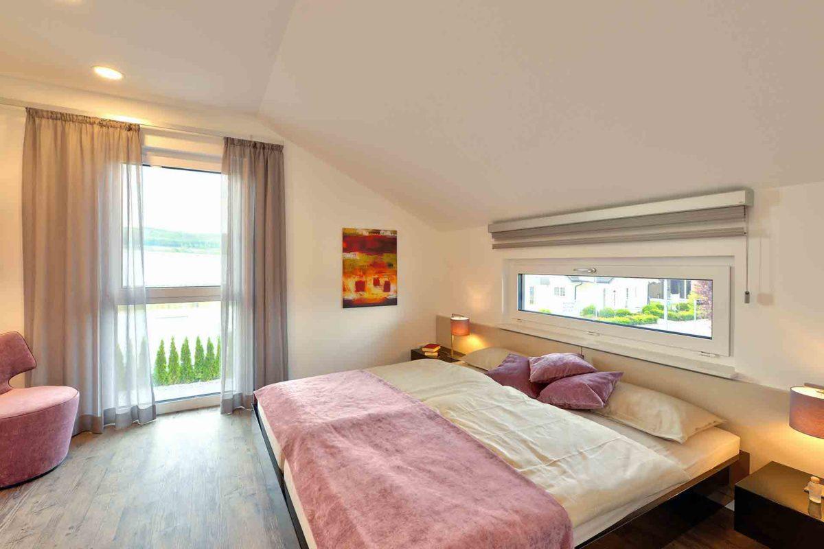 SUNSHINE 143 Mülheim-Kärlich - Ein Schlafzimmer mit einem großen Bett in einem Raum - Haus