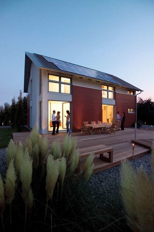 Musterhaus Mühlheim-Kärlich - Ein Haus mit Bäumen im Hintergrund - Haus