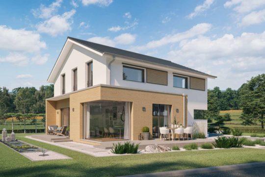 Musterhaus Linea - Ein großes Backsteingebäude mit Gras vor einem Haus - Haus