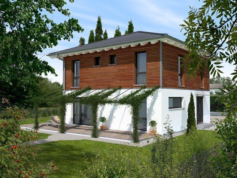 Stadthaus Variante - Ein großes Backsteingebäude mit Gras vor einem Haus - Bau-Fritz GmbH & Co. KG, seit 1896