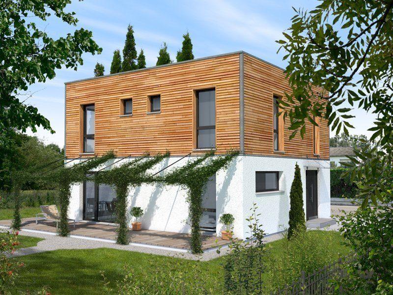 Stadthaus Variante - Ein Haus mit Büschen vor einem Backsteingebäude - Bau-Fritz GmbH & Co. KG, seit 1896