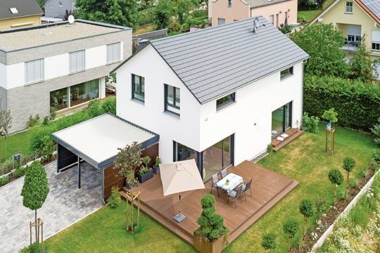 Haus Zwingenberg - Ein Haus mit Bäumen im Hintergrund - Haus