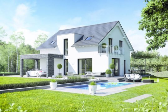 MusterHaus Bad Vilbel - Eine große Wiese vor einem Haus - Haus zeigen