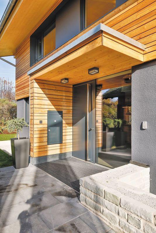 Musterhaus Poing - Eine Nahaufnahme von einem Backsteingebäude - Haus