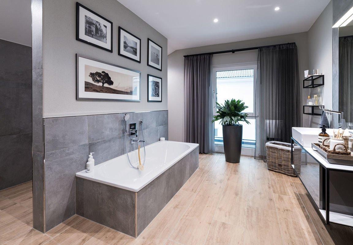 Musterhaus Medley 3.0 - Ein wohnzimmer mit waschbecken und fenster - FingerHaus
