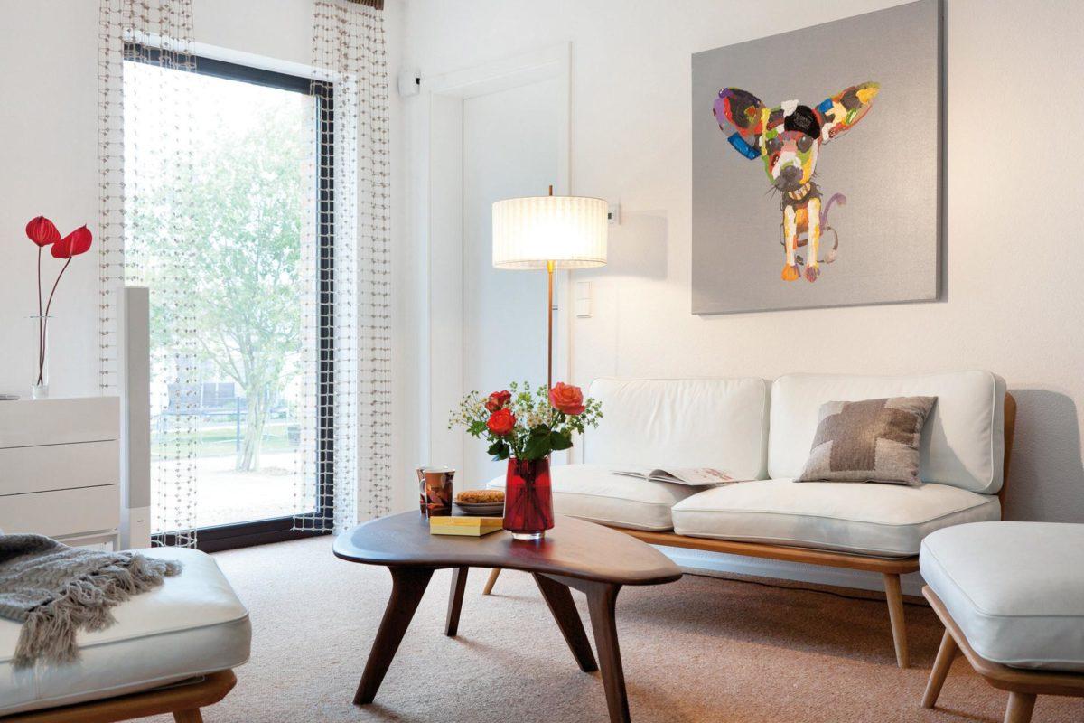 Plan E 15-140.1 - Ein Wohnzimmer mit Möbeln und einem Kamin - SchwörerHaus KG Musterhaus Helmstorf