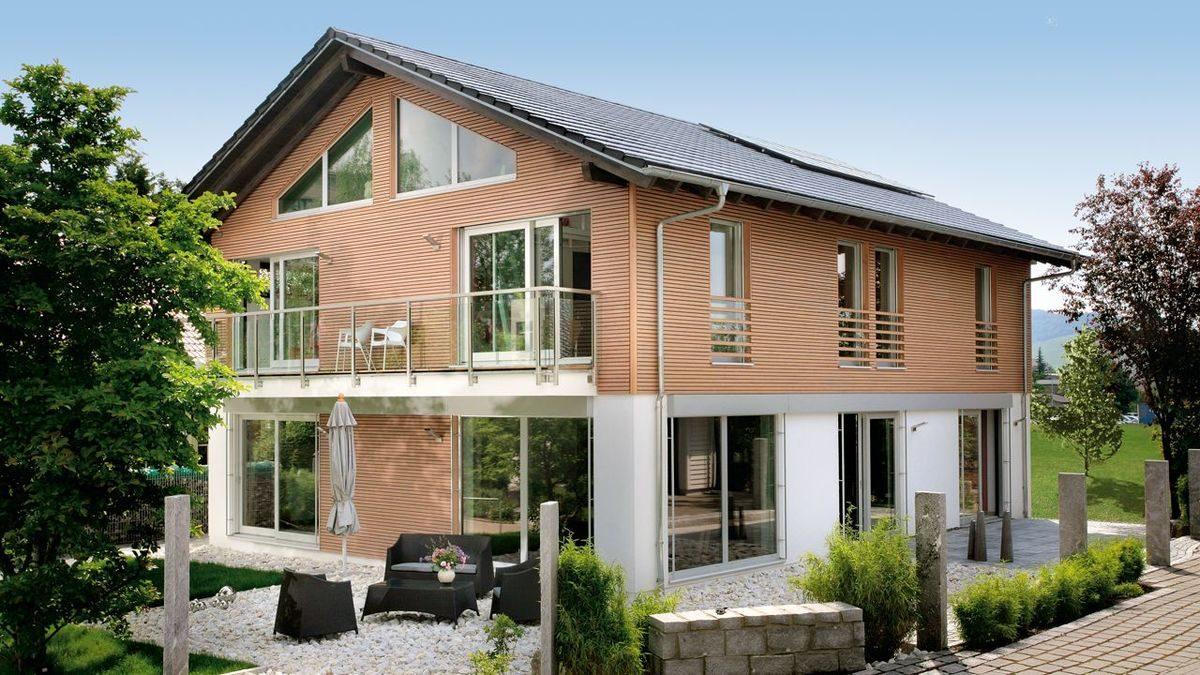 Plan E15-206.1 - Ein Haus mit Büschen vor einem Backsteingebäude - Holzhaus