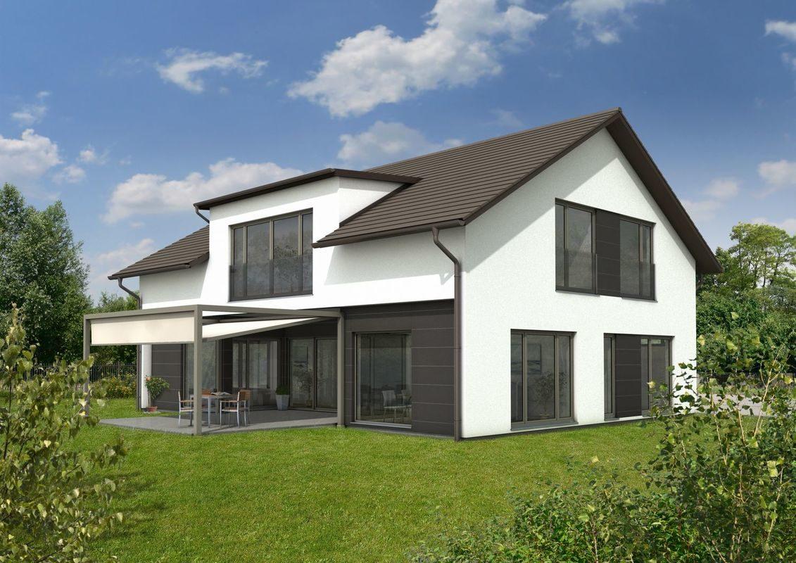 Haus Bad Vilbel - Ein großes Backsteingebäude mit Gras vor einem Haus - Keitel Haus