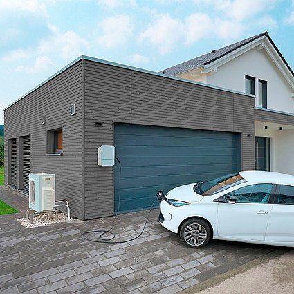 Musterhaus Schkeuditz - Ein Auto vor einem Haus geparkt - Haus