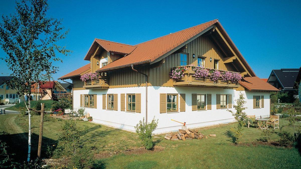 Wärme-Gewinnhaus Plan 229.3 - Eine große Wiese vor einem Haus - Haus