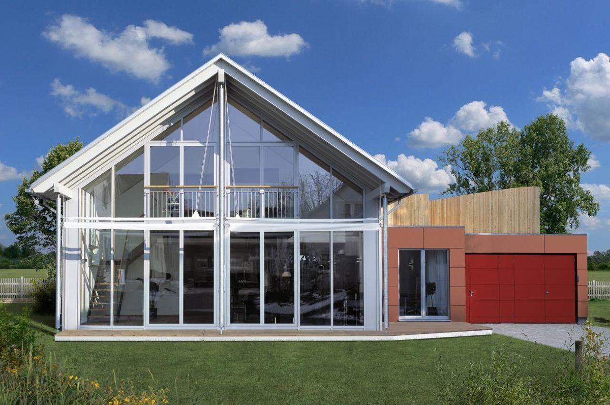Musterhaus Vario - Eine große Wiese vor einem Haus - BAUFRITZ Musterhaus
