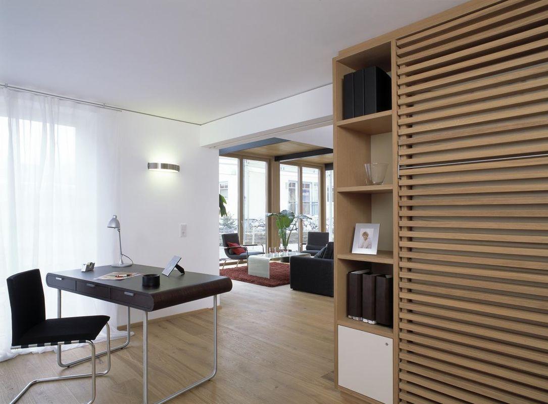 Musterhaus Vario - Ein Raum voller Möbel und ein großes Fenster - Bau-Fritz GmbH & Co. KG, seit 1896